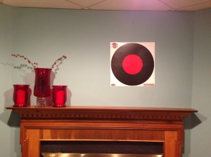 Forget family photos.  What you really need is a 3-Gun Nation target above your mantel.