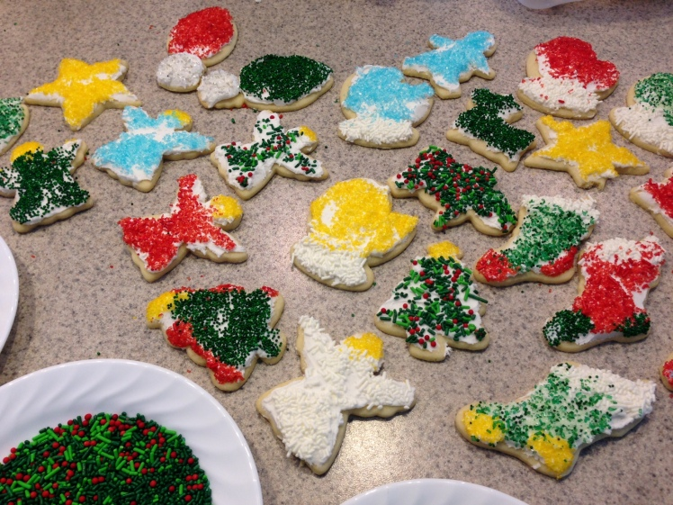 Christmas cut-out cookies.  Full of smiles and delicious SUGAR!
